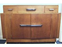 Art Deco oak sideboard, with 3 drawers, double cupboard and side drinks storage. Bowman Bros Camden.