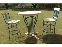 Tall bistro style table and swivel chairs