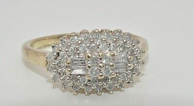 9ct gold 0.50ct diamond baguette & brilliant cut oval cluster ring size P