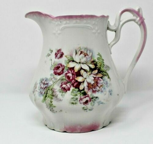 ANTIQUE WATER PITCHER