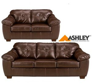 Leather couch, chair, love seat and tables