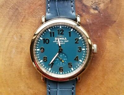 ​Shinola Runwell watch with 41mm Teal Face & Golden Bezel & Lighter Teal Band
