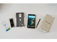 Galaxy Note 4. 32GB. Factory Unlocked (SIM FREE). 3 batteries and Otterbox Case.