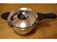 Large stainless steel sausepan with lid