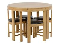 John Lewis Round Dining Table with stowaway Oak with Brown Faux Leather Chairs £119 or best offer