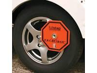 Two fullstop octagonal Excalibur Wheel Clamps