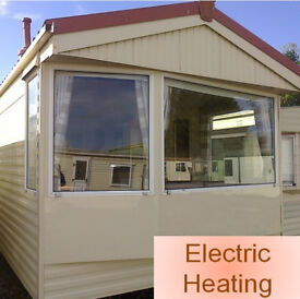 Static Caravan 32 x 10 ft 2 bedrooms, electric heating, good condition