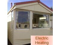 Static Caravan 32 x 10 ft 2 bedrooms, electric heating, good condition