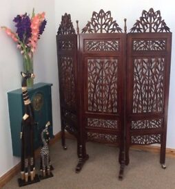 Ornate hand-carved dark wood divider screen