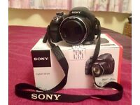 Sony Cyber-shot DSC-H400 63x Optical Zoom 20.1 Mega Pixels Digital Bridge Camera (incl camera case)