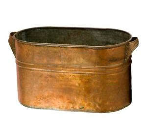 Large antique copper tub with copper handle
