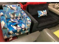 DFS velvet lustre blue armchair and black cuddle chair