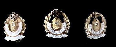 vintage General Motors Electro-Motive Diesel service pins with diamonds