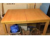 Wooden extending dining room table with 6 chairs