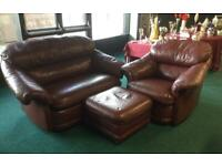 2x1 seater burgundy leather sofa and footstool