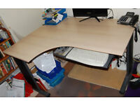 L-shaped office desk with pull-out keyboard shelf