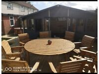 Round wooden table and 8 solid chairs garden furniture