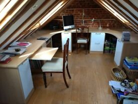 Home office fitted desk with built in cupboards and filing cabinet