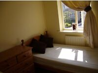 Room available in lovely 3 bedroom house, Odd Down, Bath. With parking.