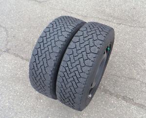 Pair of 185-65R15 snow tires on rims