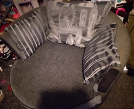 Black and grey cuddle chair swivel chair