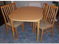 Dining Suite consisting of Extendable table and 4 chairs.