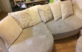 Cream corner sofa and footstool