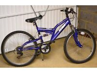 Trax-24 full suspension mountain bike complete with bike stand