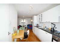spacious studio flat on first floor with private balcony and wooden flooring throughout.