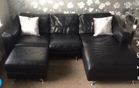 Black leather corner sofa with matching footstool
