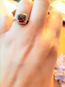Genuine 14K Garnet and diamond ladies ring for sale.