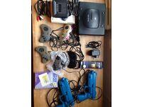 Sega Saturn multi zone, Action replay 3 in 1, 5 controllers, 2 sega guns, 1 multitap, power adaptor