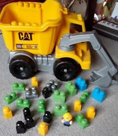Mega Bloks CAT dumper truck with blocks and figure