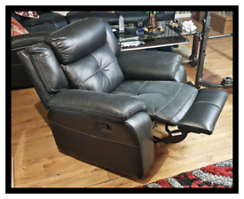 Harveys Langdale black manual reclining armchair. Good condition.