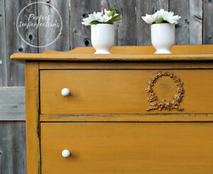 Beautifully restyled antique dresser in mustard & delicate knobs