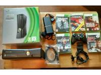 RARELY USED X BOX 36O S 250GB ,CONTROLLER,BATTERY POWER PACK AND CABLE AND 5 GAMES
