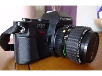Pentax P30 SLR with accessories