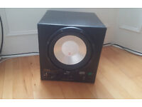 Big REL Q-bass Subwoofer with built-in amplifier for home surround system.