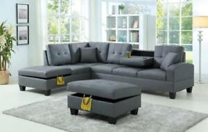 Grey Leatherette Sectional with Storage and Drop Down Cup Holders Just $799