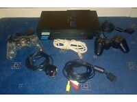 PS2 with PS1 and PS2 games and accessories