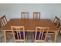Dining table and 6 chairs - table extends and chairs have removable covers