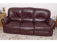 Burgundy leather lounge suite.