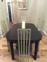 almost new modern style dining table and 6 metal framed chairs