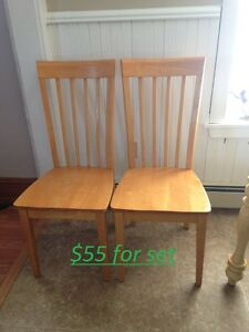 set of two solid wood chairs