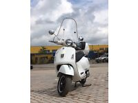 PIAGGIO VESPA GTS 125i.e. WITH TOP BOX AND FRONT SCREEN SUPERB CONDITION 2009 SIMPLY STUNING