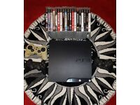 PS3 Slim with 25 games