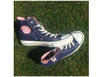 Purple, pink and white all star hi top converse
