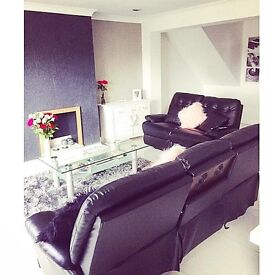 Two and Three Seater Excellent Condition Black Leather Reclining Sofas.