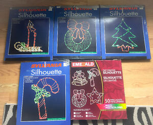 **FOUR LIGHT UP CHRISTMAS WINDOW DECORATIONS FOR SALE**