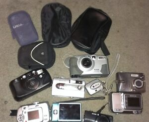 VARIOUS DIGITAL CAMERAS & CASES - AT LEAST 8 - ALL NEED REPAIRS